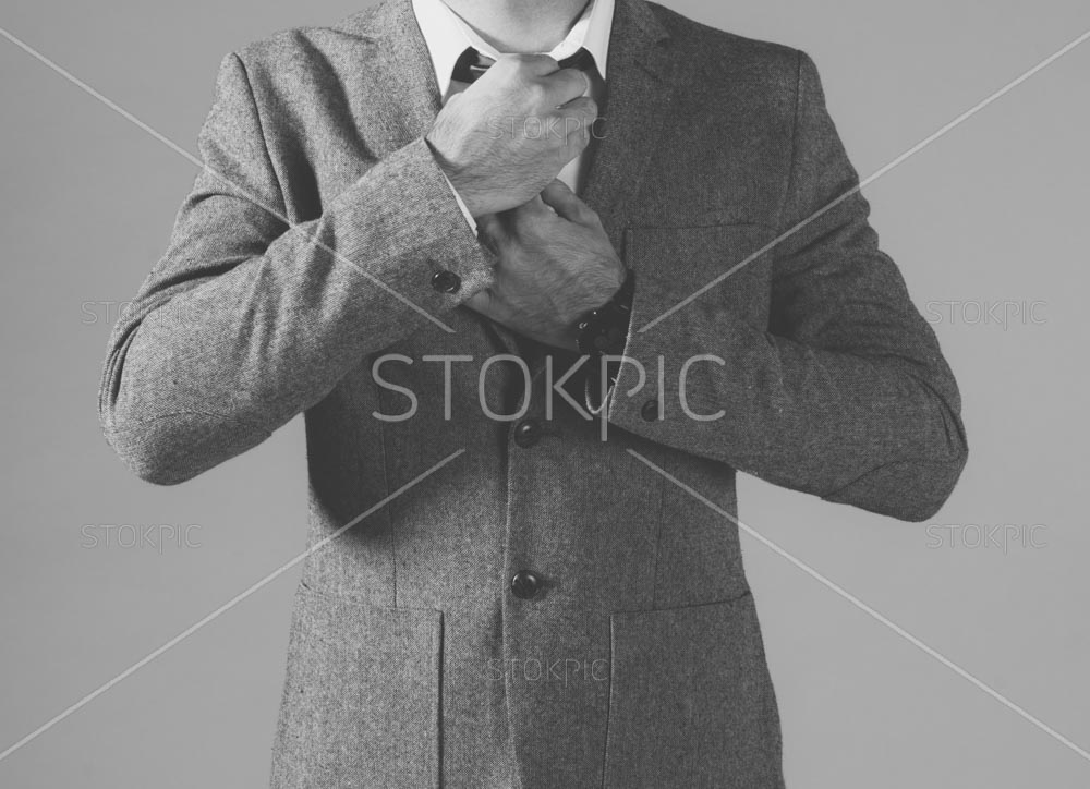 B&W Man In Fashion Jacket Straightening Tie