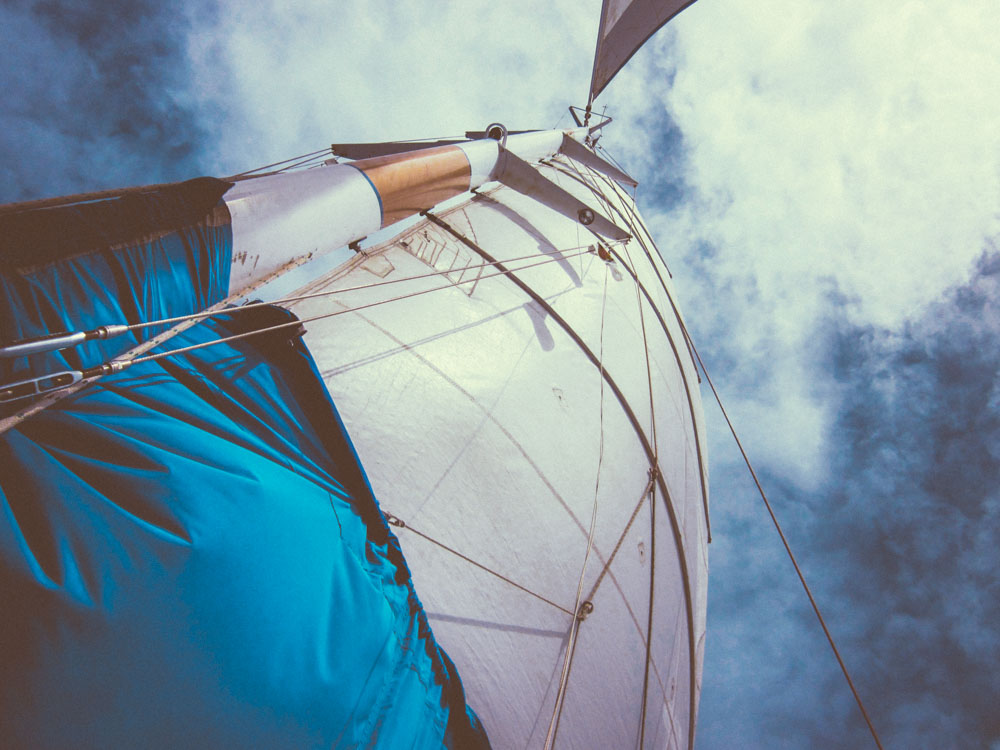 Blue And White Boat Sail Perspective