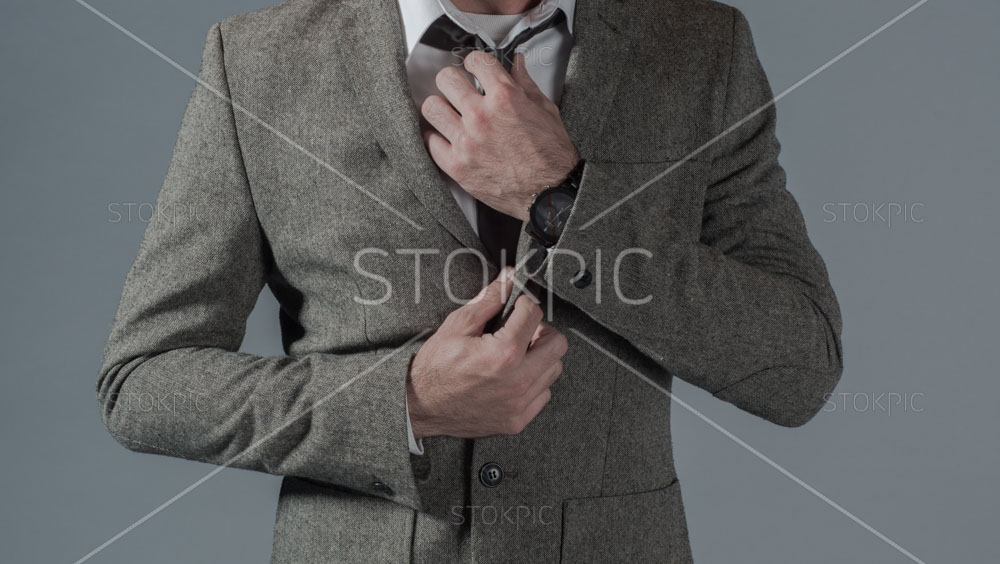 Male Fashion Winter Jacket And Grey Jeans Straightening Tie