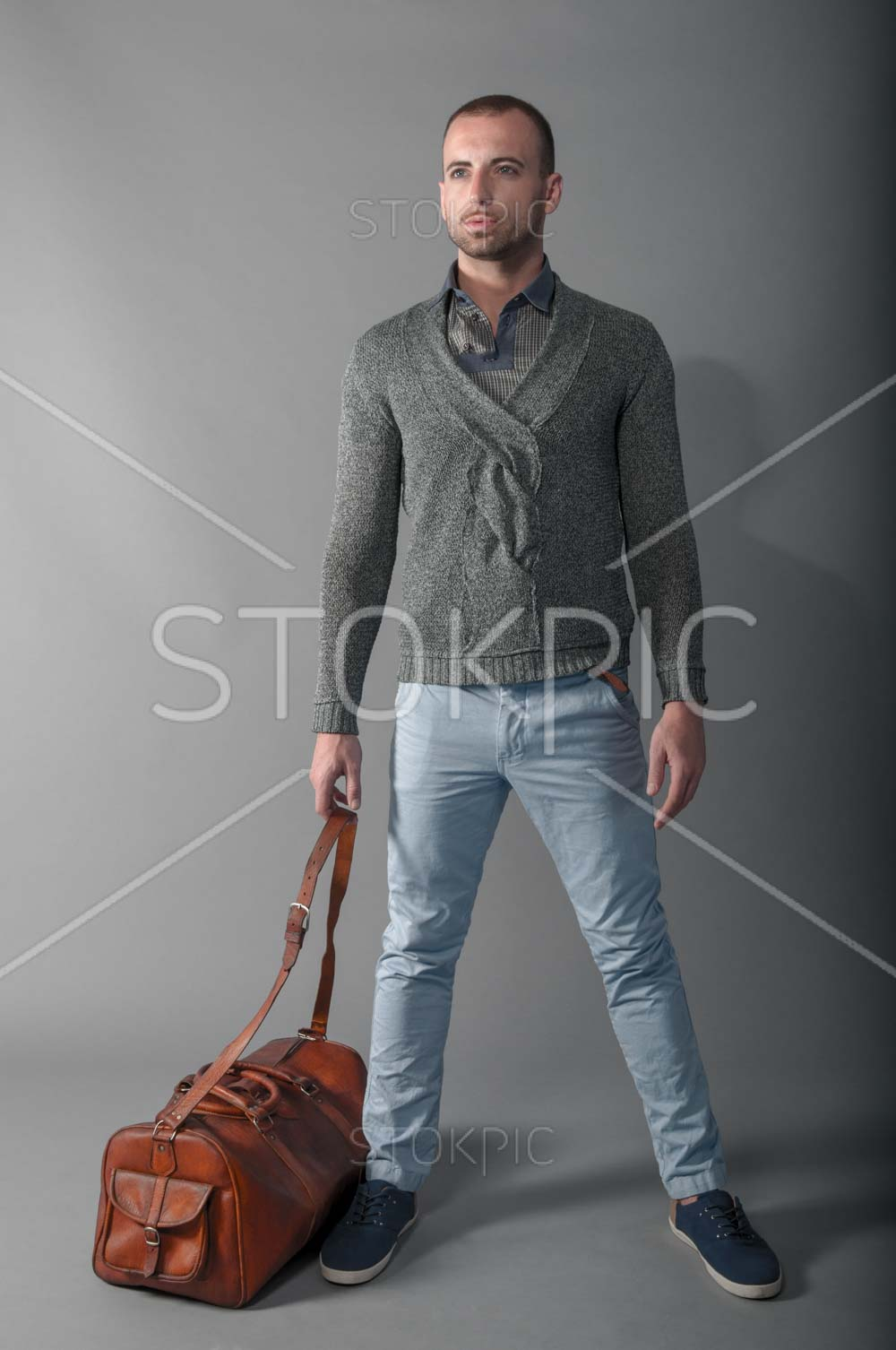 Man In Autumn Fashion With Leather Bag Standing