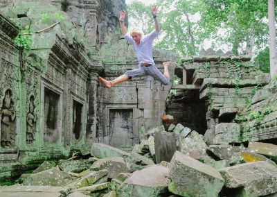 Man Jumping In Old Temple Ruins