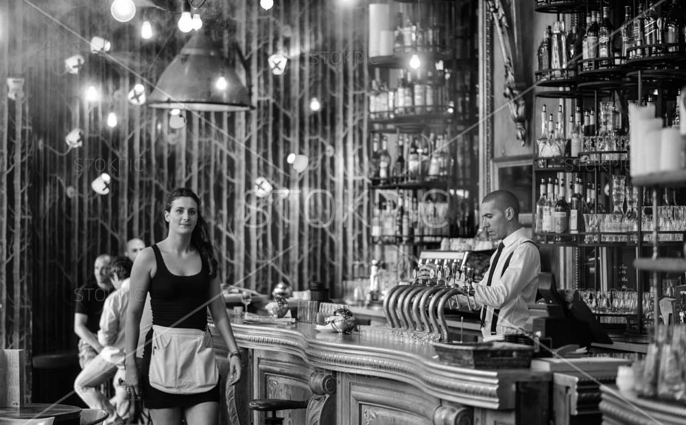 Barman And Waitress In Old Style Cafe In Paris