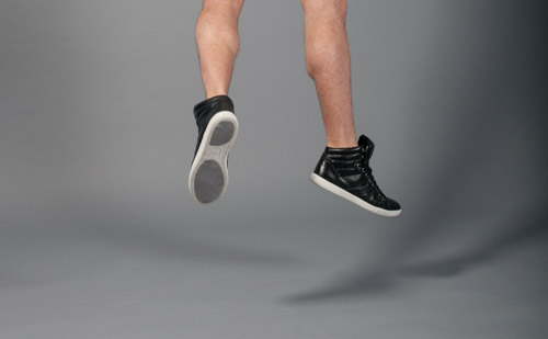 Mens Fashion Kicks Jumping On Grey Background