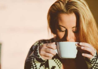 Blond Girl  Peacefully Drinking Coffee At Sunrise