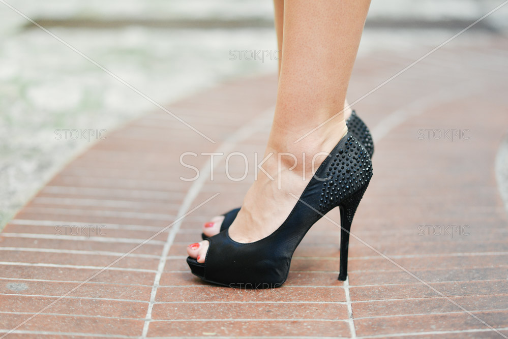 Close Up Of Woman Wearing Black Evening Heals