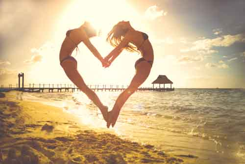 Girls On Beach Jumping To Make Cute Love Heart