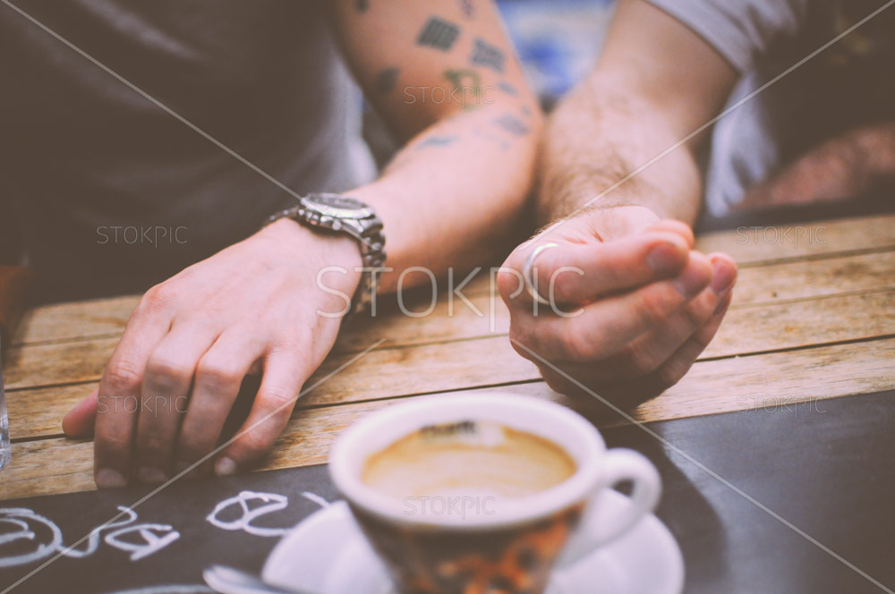 Hands Od Friends Socializing In A Coffee Shop