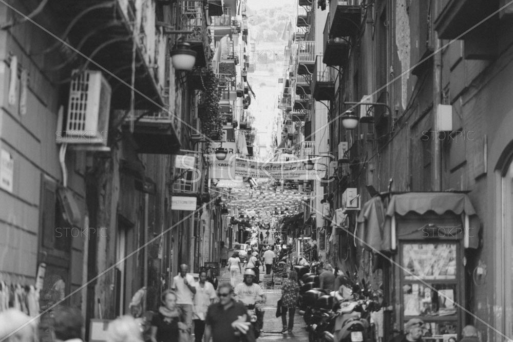 Busy Italian Back Street With People and Buildings
