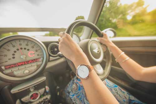 Girl Driving With Hands On Steering Wheel