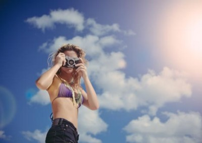 Cute Girl In Bikini Taking Photo With Retro Camera