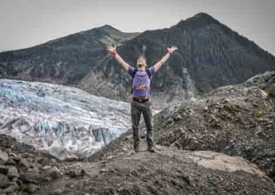 Man Celebrating Freedom In nature With Glacier