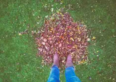 Man Standing In Autumn Leaves