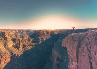 Man Celebrating At The Grand Canyon While Travelling