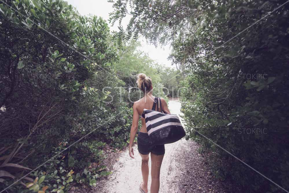 Girl With Beach Bag Walking In Nature