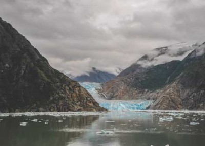 Glacier In Alaska With Dramatic Mountains