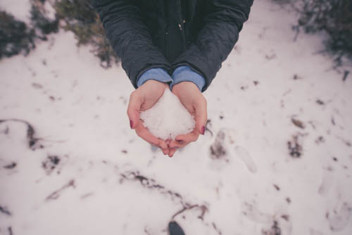 Girl Holding Winter Snow In Hands