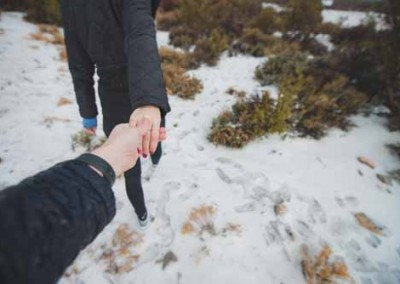 Hiking And Holding Hands in Winter Snow