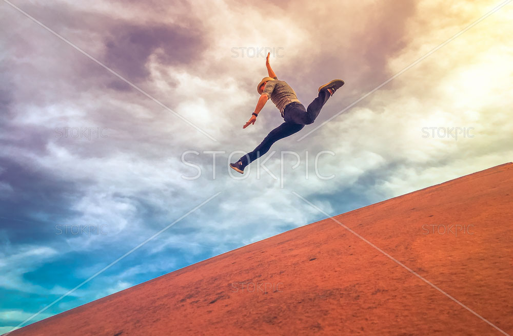 Free images of Man Jumping Down A Hill