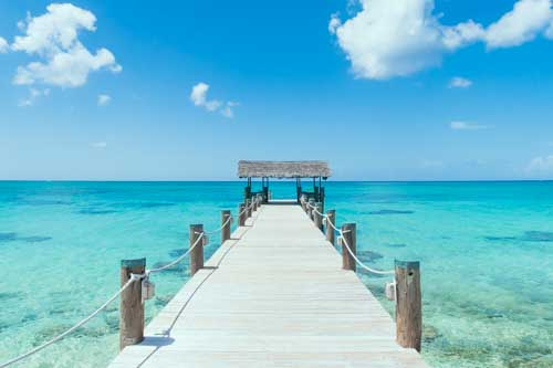 Island Pier On Perfect Tropical Beach With Blue Water